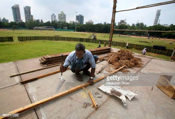 Workers work on the the stage on Sunday built for the Shiv Sena Dussehra Rally which is on 6th October at Shivaji Park Ground Dadar