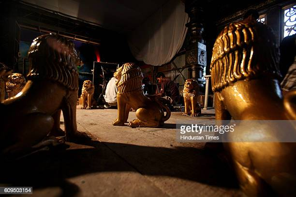 Workers working on a idol as they are sculpting a replica of the entire Tirupati temple in Thakur Village Borivali for the Ganeshotsav