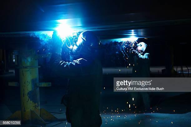 Workers working on ship at shipyard, GoSeong-gun, South Korea