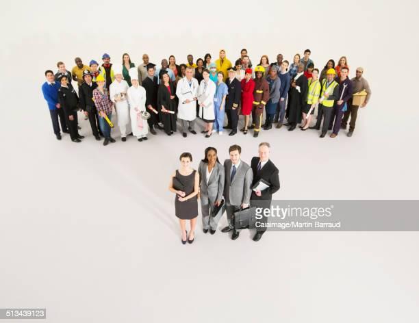 Workforce behind confident business people