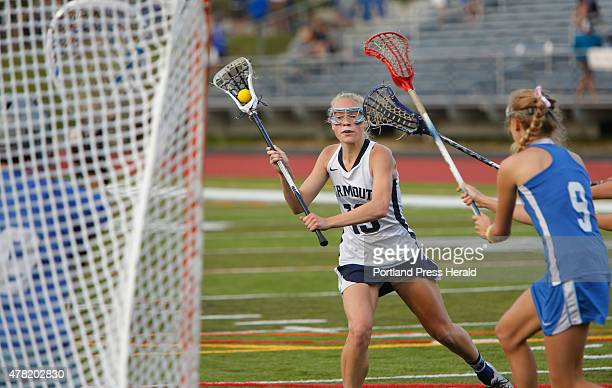 Working an opening in the Kennebunk defence Eliza Lunt of Yarmouth looks to fire a shot on goal during the girls Class B lacrosse state final at...