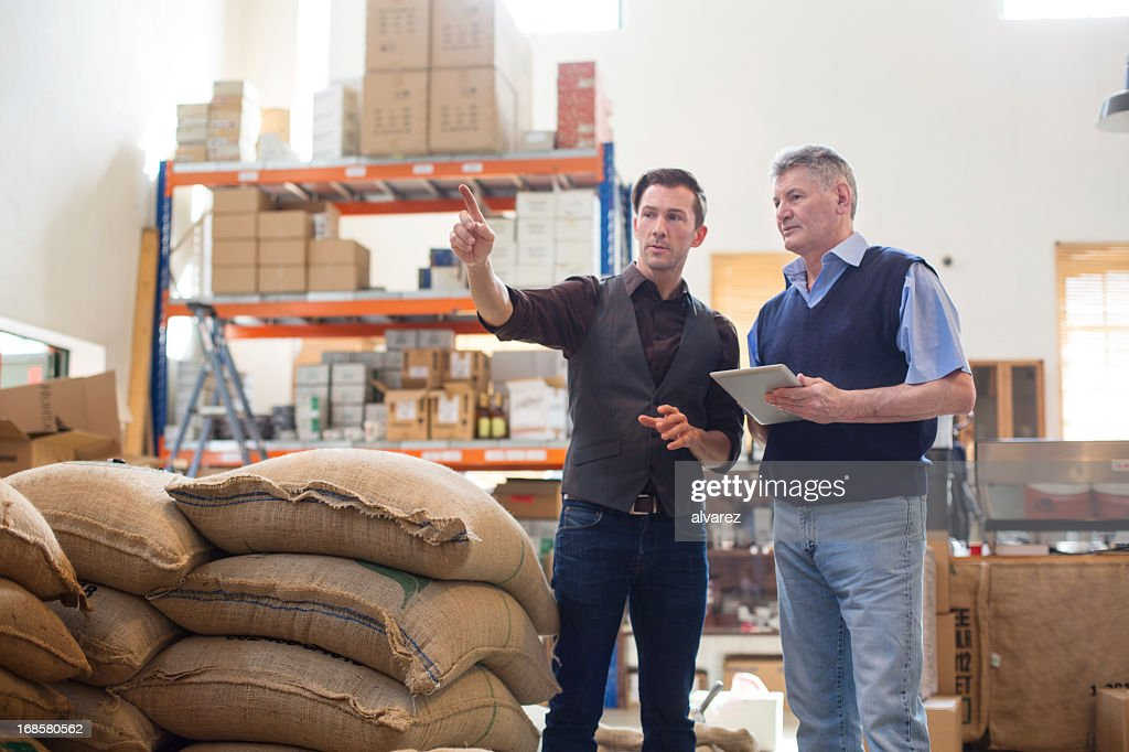 Working at a coffee storage room : Stock Photo