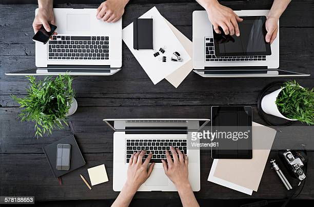 Working at home office with laptop, smartphone and digital tablet