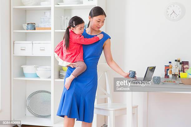 Working Chinese Mother and Little Girl