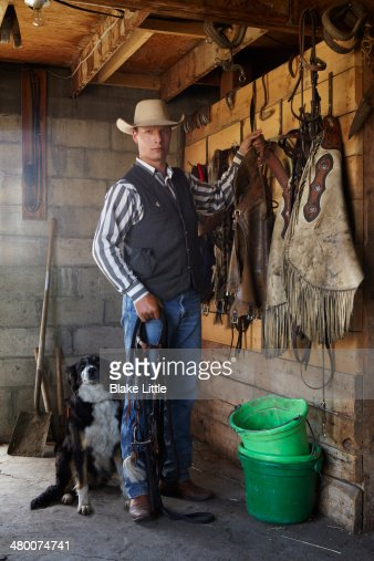 Working cowboy in tack room : Stock Photo