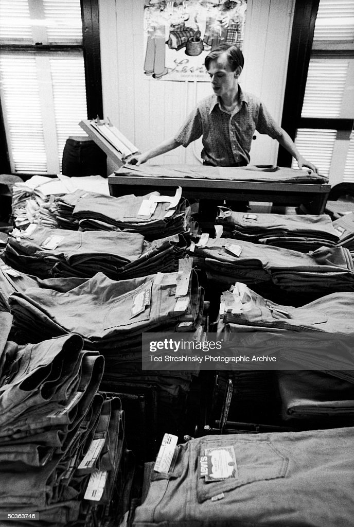 Working folding pair of Levi's at factory.