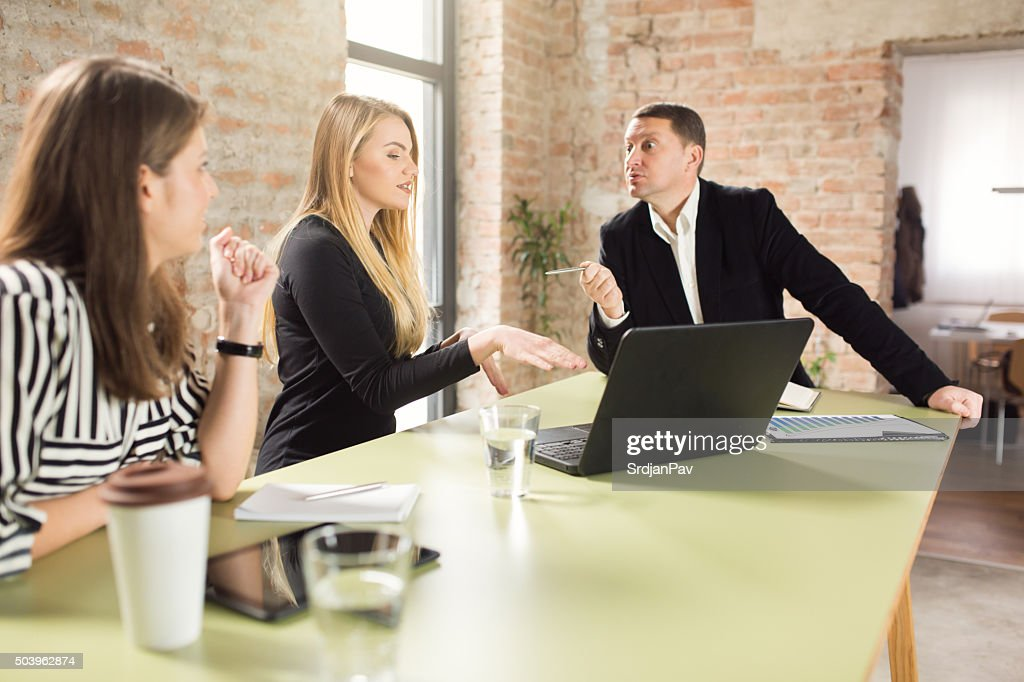 Working For A Tough Boss : Stock Photo
