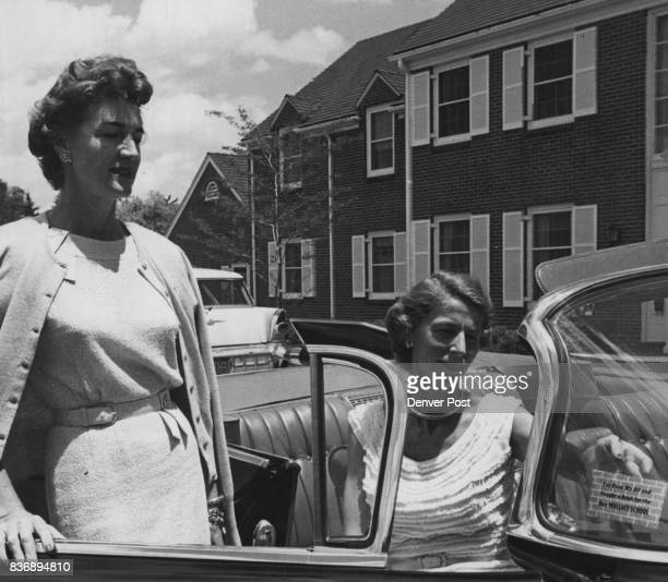 Working for Wallace School Mrs J Kenneth Malo pastes a paper brick on the windshield of her car as Mrs Donald Magarrell looks on They are selling the...