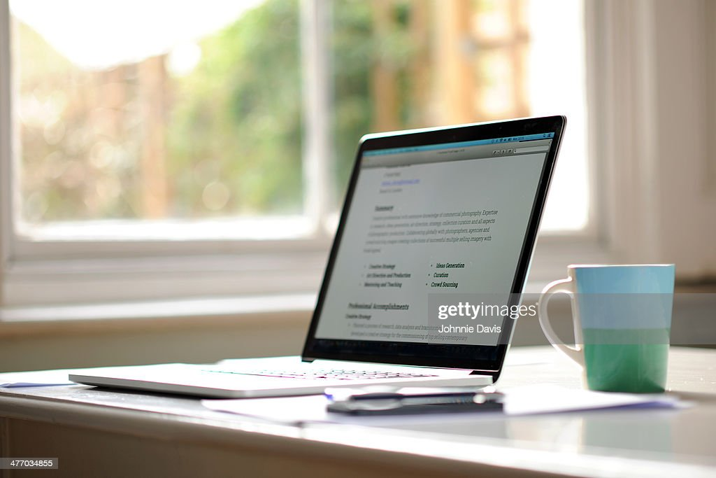working from home, laptop with mug by a window