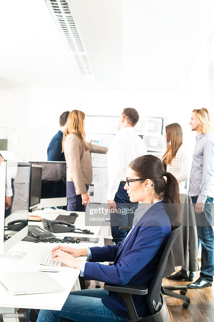 Working in a modern office : Stock Photo