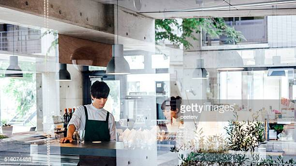 Working in cafe, Japan.