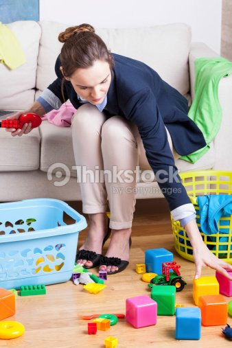 Working Lady Cleaning Up Toys Stock Photo Thinkstock