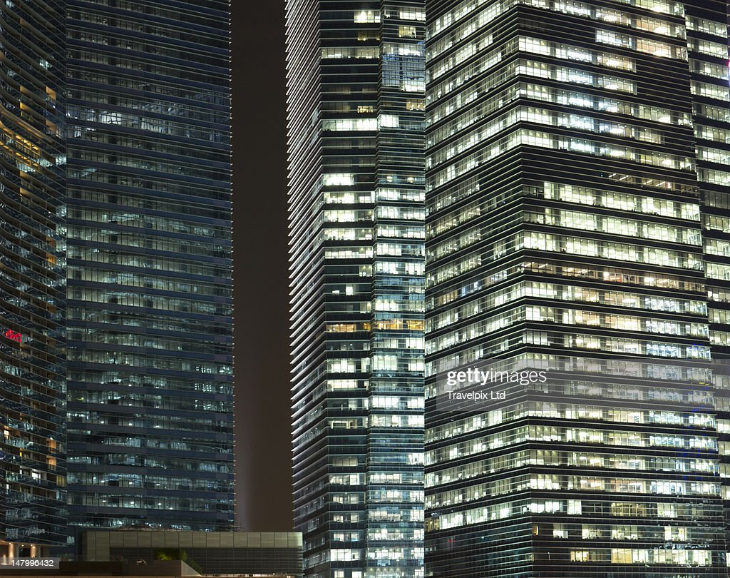 Working late, modern office blocks, Singapore : Stock Photo