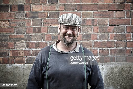 Working middle-aged male in flat cap