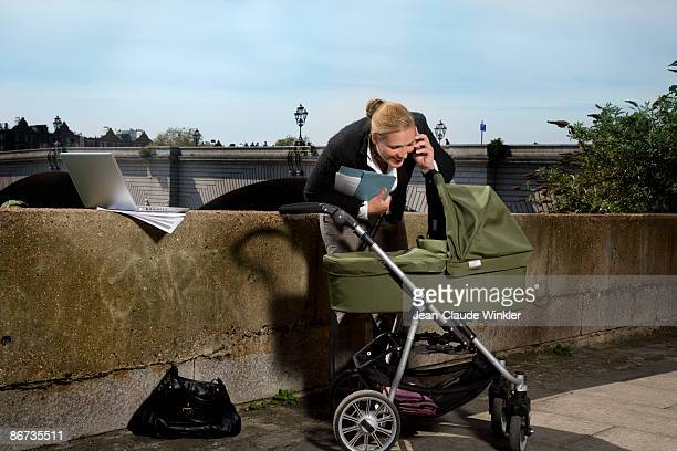 working mother on mobile phone outdoors