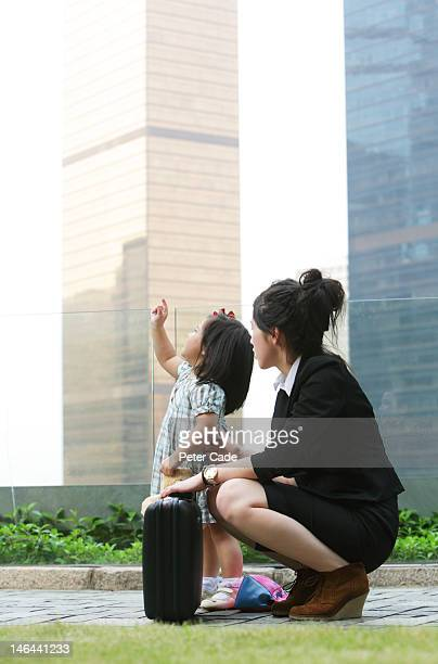 working mother with child in city