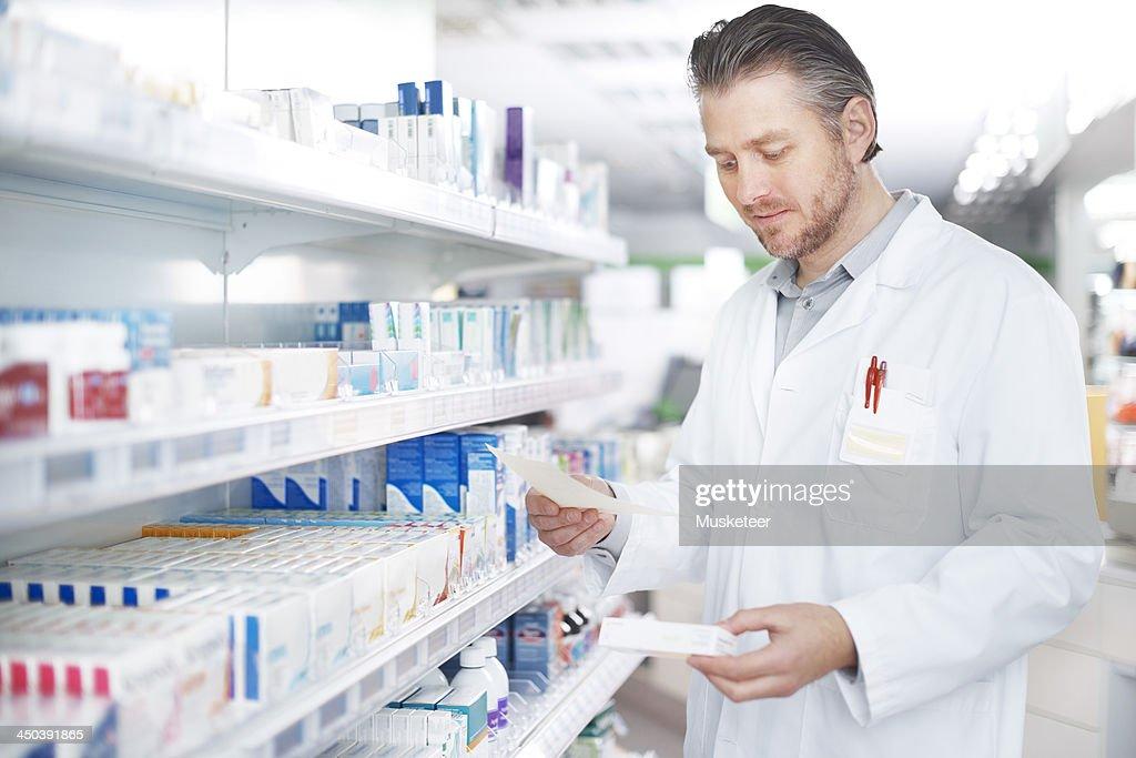 Working on a prescription : Stock Photo