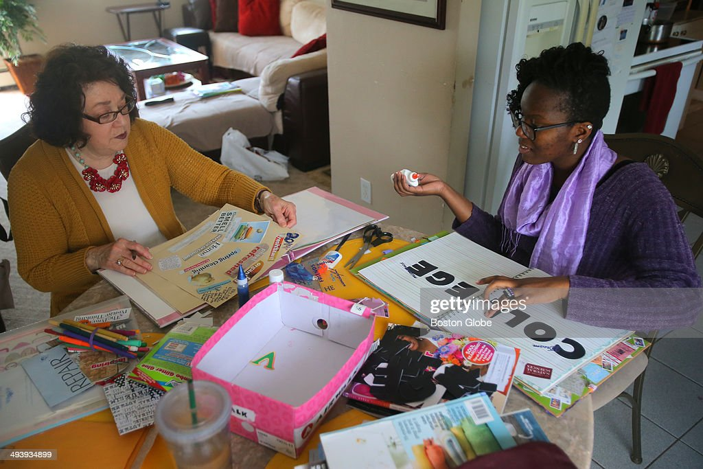 Working on a scrap book focused on dreams and goals, Vicky Nkinzi and her mentor Donna Mollin, share time in Nkinzi's Framingham kitchen. Vicky Nkinzi, 17, of Framingham, is a first generation American whose parents immigrated from Uganda. The Framingham High senior has worked with a mentor, Donna Mollin, 69, of Northboro, through the John Andrew Mazie Memorial Foundation (JAMMF) for the last few years and earned a full ride to any Massachusetts state college of her choice. She will graduate with honors in June.