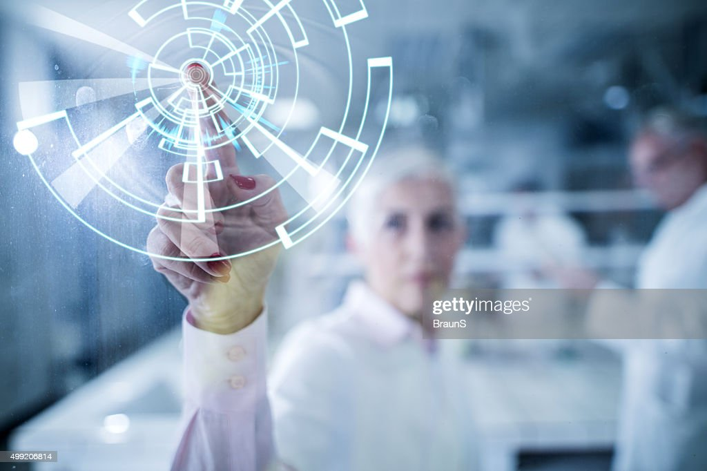 Working on futuristic innovation on a touch screen. : Stock Photo