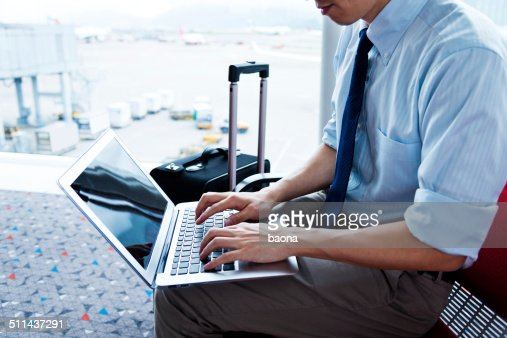 working on laptop in the airport
