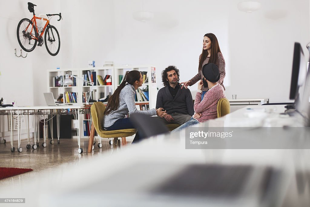 Working on new apps. Young business group. : Stock Photo