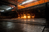 Working open hearth furnace. Production process in the steel mill.