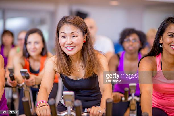 Working Out in Aerobic Cycling Class