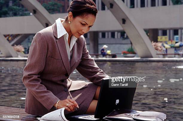 Working outside on her laptop