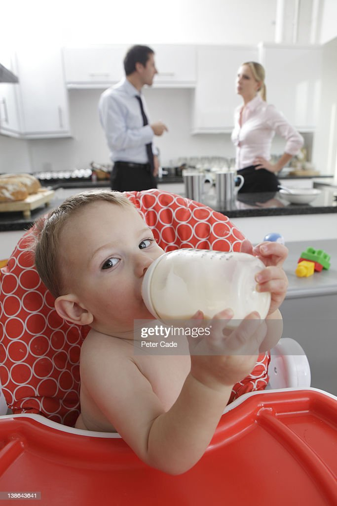 working parents arguing behind baby : Stock Photo