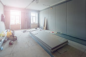 Working process of installing metal frames for plasterboard (drywall) for making gypsum walls  in apartment is under construction, remodeling, renovation, extension, restoration and reconstruction.