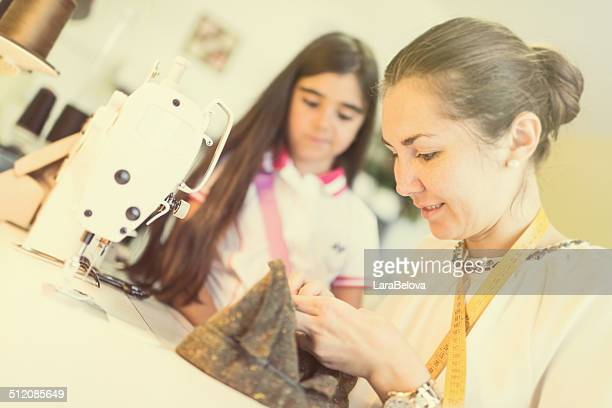 Working tailor woman with daughter