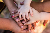 A group of hands piled together