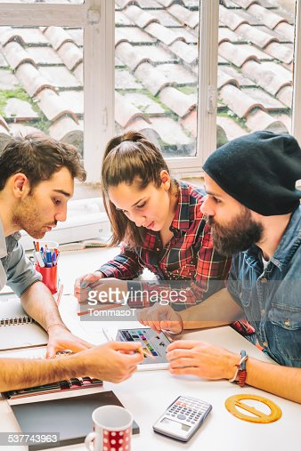 Working together with a tablet in office