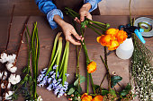 Hands of florist making a beautiful bouquet