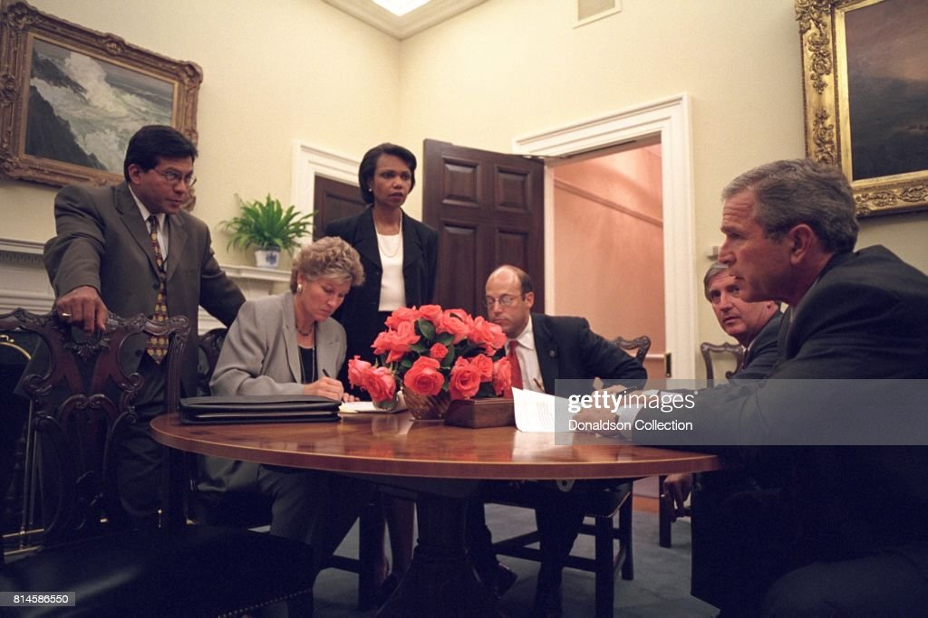 Working with his senior staff, President George W. Bush reviews the speech that he will deliver to the nation from the Oval Office the evening of Tuesday, Sept. 11, 2001. Pictured from left are: Alberto Gonzales, White House Counsel; Karen Hughes, Counselor; Condoleezza Rice, National Security Adviser; Ari Fleischer, Press Secretary, and Andy Card, Chief of Staff. Photo by Paul Morse, Courtesy of the George W. Bush Presidential Library/Getty Images