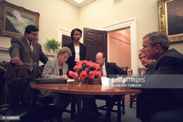 Working with his senior staff President George W Bush reviews the speech that he will deliver to the nation from the Oval Office the evening of...
