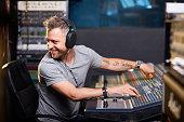 Happy sound operator worknig in studio