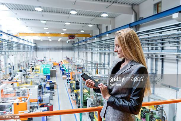 Working with tablet in futuristic factory