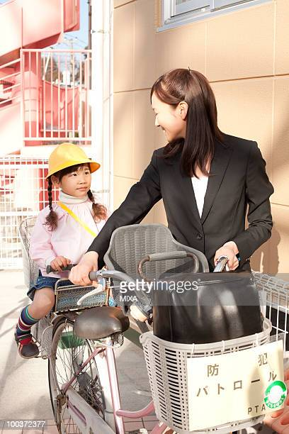 Working Woman Taking Daughter to Day-care Center