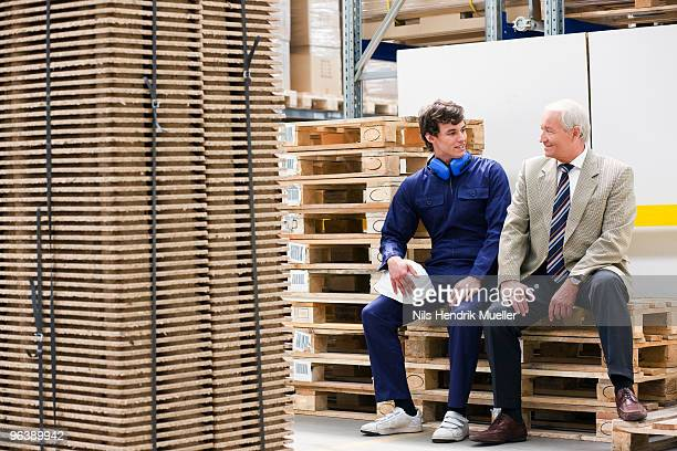 workman and boss in storage