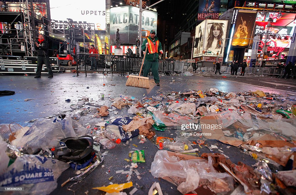 Workman begin the task of cleaning up after thousands of revelers gathered in New York's Times Square to celebrate the ball drop at the annual New Years Eve celebration on December 31, 2011 in New York City.