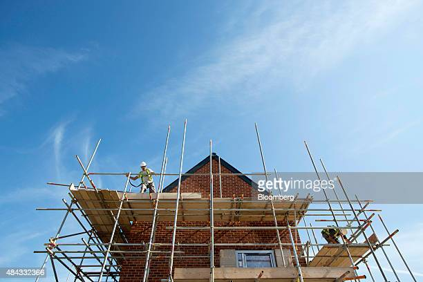 A workman breaks down scaffolding on a building exterior at a Persimmon Plc construction site in Uxbridge UK on Monday Aug 2015 Persimmon Plc the...
