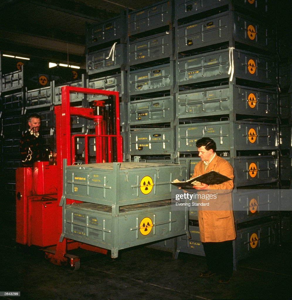 A workman checking crates at a nuclear power station.
