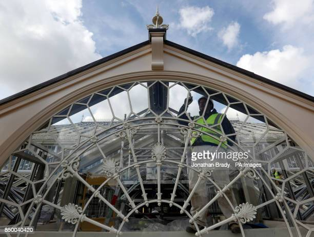 A workman in the Royal Botanic Gardens in Kew SW London paints the Temperate House that will reopen in May next year after the pound41 million five...