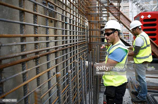 Workman install concrete reinforcement rods during building works at Balfour Beatty Plc's St James's Market construction site a joint Crown Estate...