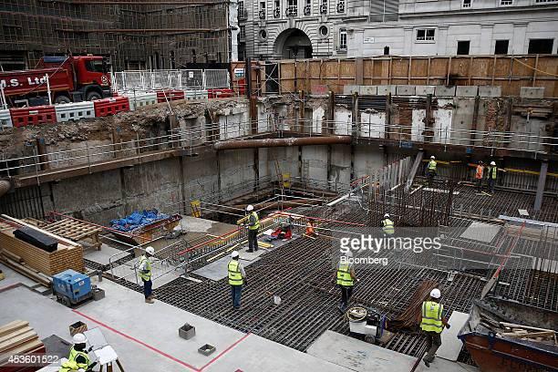 Workman install concrete reinforcement rods for building groundworks at Balfour Beatty Plc's St James's Market construction site a joint Crown Estate...