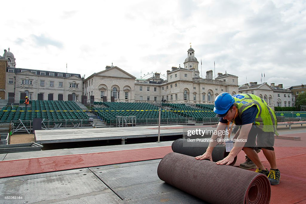 A workman lays the track for the Sainsbury's Anniversary Games at Horse Guards Parade on July 17, 2014 in London, England. Sections of the track from the London 2012 Olympic Stadium are being reused in the temporary stadium in the iconic setting of Horse Guards Parade that will host The Sainsbury's Anniversary Games on Sunday 20th July.