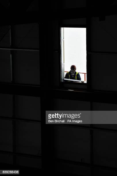 A workman looks through a window aperture from inside the pier as construction continues on the Grand Pier at WestonsuperMare in preparation for...