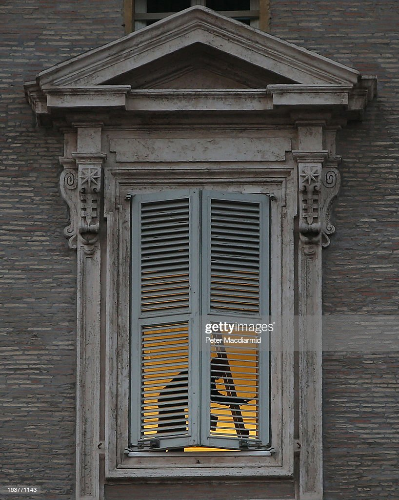 A workman paints the windows in the Papal apartments on March 15, 2013 in Vatican City, Vatican. Pope Francis is expected to move in to the accommodation after renovation work is completed in the next few days.