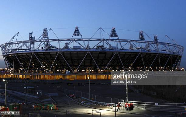 A workman passes by the Olympic Stadium built for the London 2012 Olympic Games in east London on January 26 2012 The opening ceremony of the 30th...
